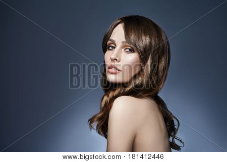 Beautiful Woman Portrait With Long Hair On Dark Background