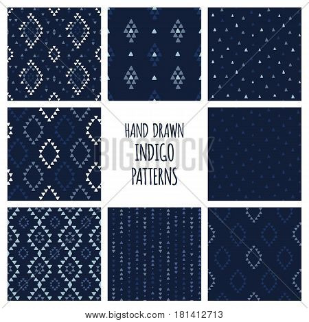 Set of hand drawn indigo blue patterns. Seamless native american backgrounds with triangles, arrows, rhombuses and diamonds. Vector illustration.