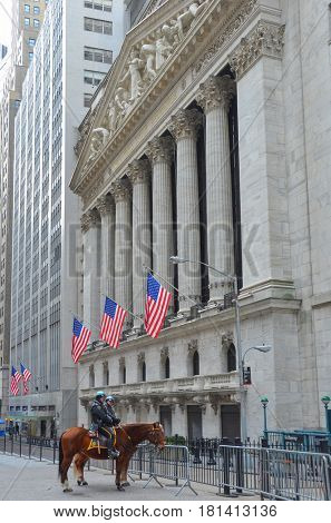 NEW YORK CITY, NY - JANUARY 7: Wall Street New York Stock Exchange Building and the mounted policemen in front. It is the world's largest one by market capitalization of its listed companies.