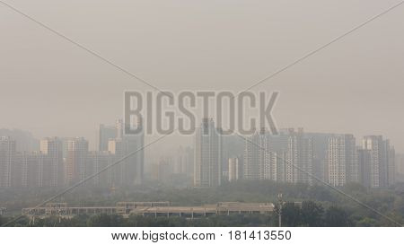 18th Sep2014-BeijingChina. Wide angle horizontal shot of buildings in beijing on a foggy day.the word on building show the name of bussine company