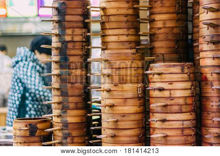 22Dec2015Chong qing column of steamer baskets of Dim Sum a chinese women wokring behind it selling chinese food