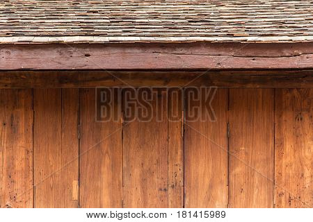 wood house background vintage wooden traditional door in north Thai style for background.