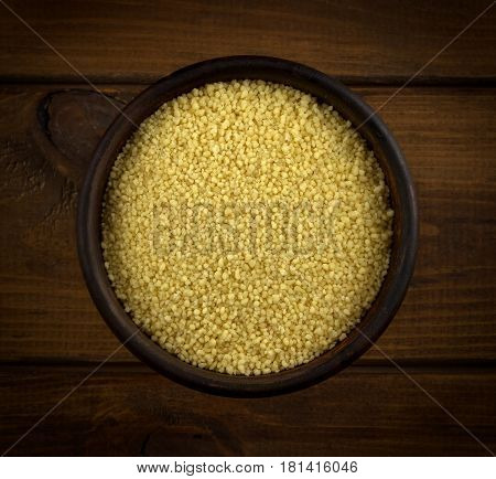 Couscous into a bowl on the table