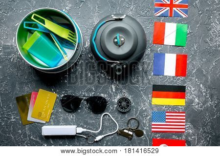 Traveler's accessories, power bank and credit cards in vacation concept on gray table background top view