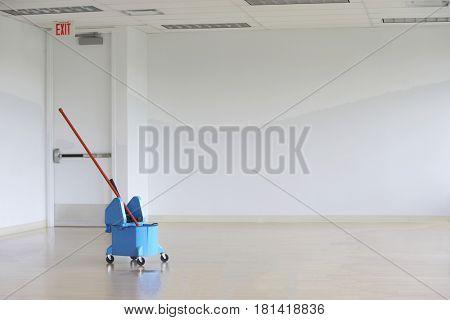 Mop and bucket in corridor