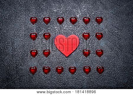 Rows Of Small Plastic Hearts And Big Wooden One. The Concept Of The One True Love