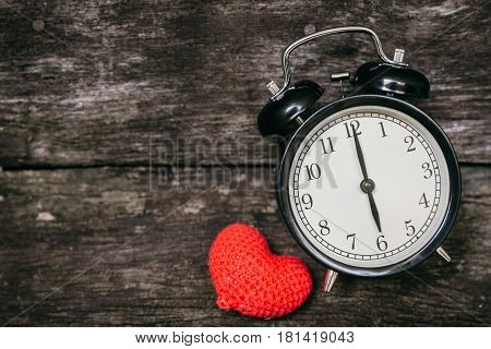 Love Clock At 6 O'clock, Time Of Sweet Loving Pass Memories Story On The Old Wood Background.