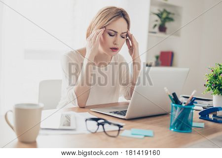 Overworked Businesswoman Suffering From Headache And Thinking How To End Project