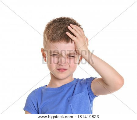 Little boy suffering from headache on white background