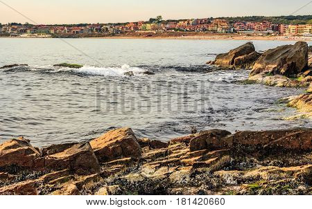 SOZOPOL BULGARIA - SEPTEMBER 11 2013: rocky shore and sandy city beach in mellow season. Beautiful and warm weather on the coast of Black sea.