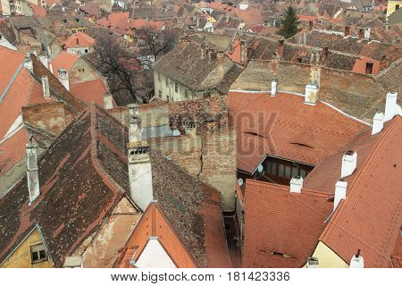 View from above of the red roofs of old houses in the medieval city of Sibiu, Romania.
