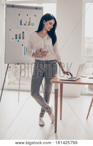 Beautiful Pretty Young Business Woman In A Coffee Break Working With A Laptop Standing Beside A Flip