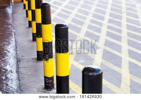 Loading Zone or Temporary car parking area with cross line and yellow black color paint stripe.