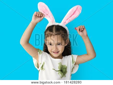 A caucasian girl with a bunny hairband.