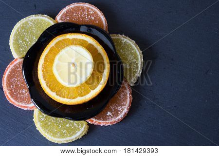 Colorful sugary marmalade like lemon and orange slices covered with sugar. Fruit jelly candies.