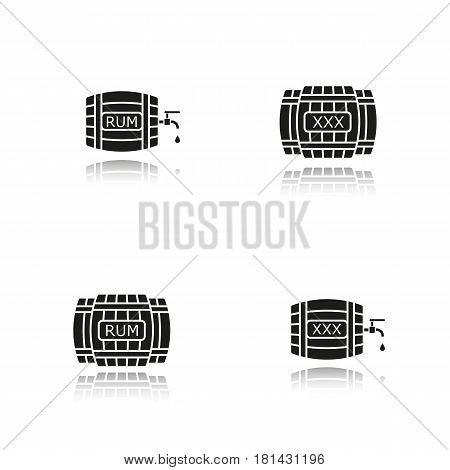 Alcohol wooden barrels drop shadow black icons set. Rum or whiskey wooden barrels with tap, drop and xxx sign. Isolated vector illustrations
