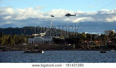 Canberra Australia - March 18 2017. Low flyover by the Snowy Hydro Southcare Rescue Helicopter at Regatta Point in the Commonwealth Park.