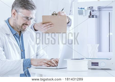 Scientist Preseting The Printer