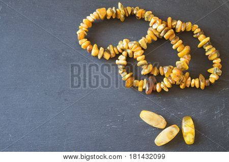 Amber. Beads from amber. Amber necklace on stone background