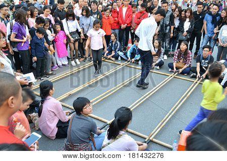 Hanoi Vietnam - Feb 19 2107 : People playing Bamboo clapping at Hanoi Night Market on Hang Dao Walking Street