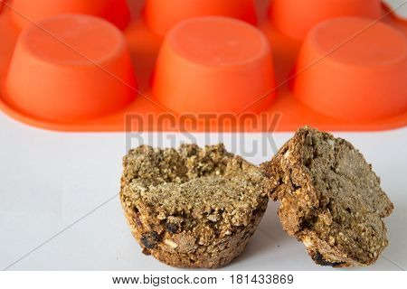 Bread from rye flour with seeds in silicone orange bakeware white background