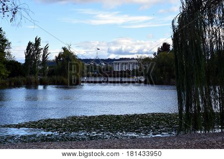 The view of Parliament House and Molonglo River from Commonwealth Park.