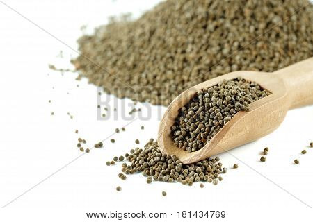 Perilla frutescens or sesame in wood spoon on white background.