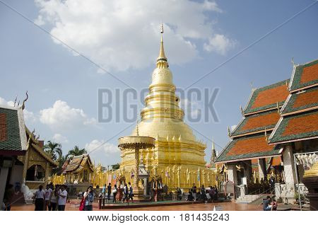 Asian Thai People And Foriegner People Respect Praying And Walk Visit Gold Chedi At Wat Phra That Ha