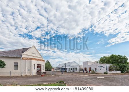 ABERDEEN SOUTH AFRICA - MARCH 23 2017: A street scene with the hall of the Dutch Reformed Church and a book shop in Aberdeen a small town in the Eastern Cape Province.