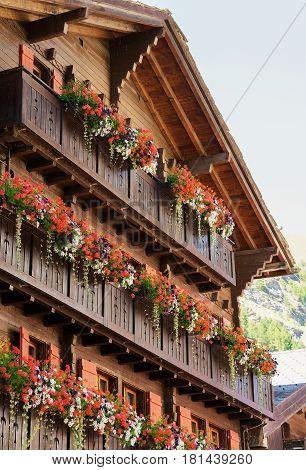 Chalet With Flowers On Balconies At Zermatt Village Switzerland