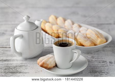 Madeleines vanilla cookies with coffee cup on plate