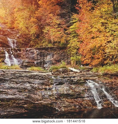 Beautiful waterfall surrounded by New England fall foliage