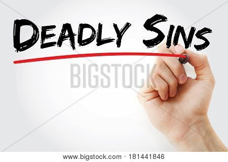 Hand Writing Deadly Sins With Marker