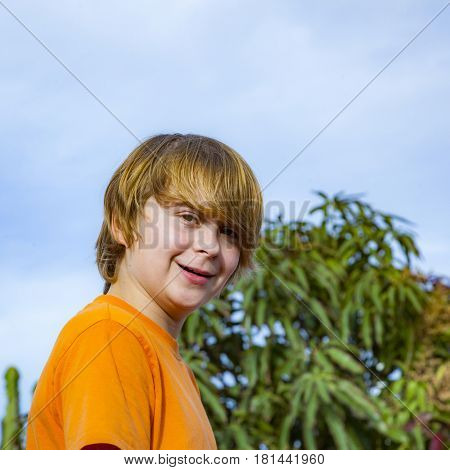 Happy Boy Smiling Under Blue Sky