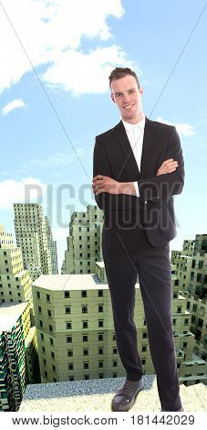 Young businessman on top of rendered building view
