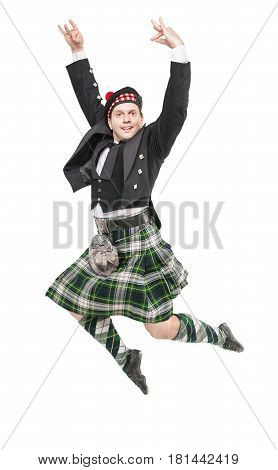 Handsome Man In Traditional Scottish Costume Jumping