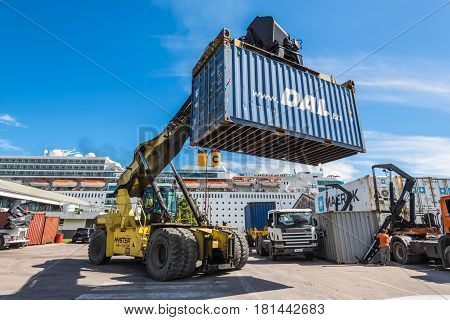 Victoria Mahe Seychelles - December 16 2015: Forklift handling container box loading at dockyard in Victoria port Mahe island Seychelles.