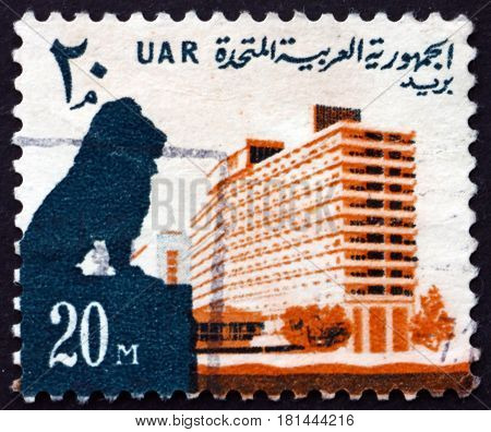 EGYPT - CIRCA 1964: a stamp printed in Egypt shows Lion and Nile Hilton Hotel circa 1964