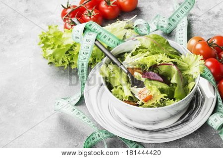 The Dietary Mixed Greens Salad (mesclun, Mache, Lettuce) And Cherry Tomatoes In A Bowl On A Light Ba