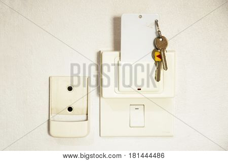 Device card insert to power switch control of the electric and key on wall in the room at resort