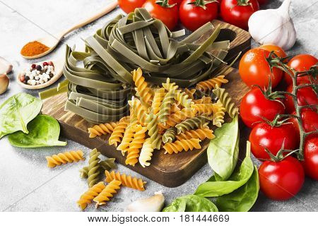 Raw Paste Of Tagliatelle With Spinach And Fusilli Paste With Spinach And Tomatoes, And Ingredients F