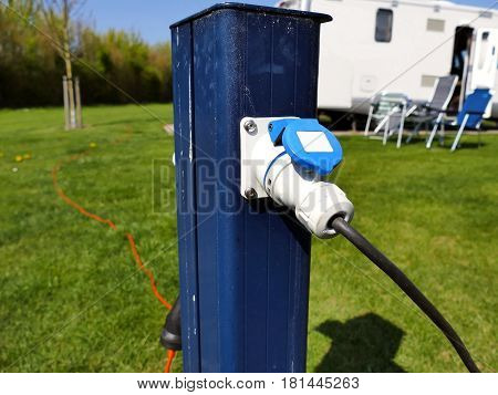 AC power sockets at a camping site Full service campground electricity with camper motor home in background