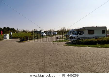 Ouddorp aan Zee The Netherlands - April 9 2017: Drive-In Camperpark campground Klepperstee scenery freedom camping with camper motor homes
