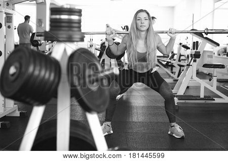 Girl In Bright White Gym. Athletic Slender Sexy Blonde Woman Doing Strength Exercise For Group Of Le