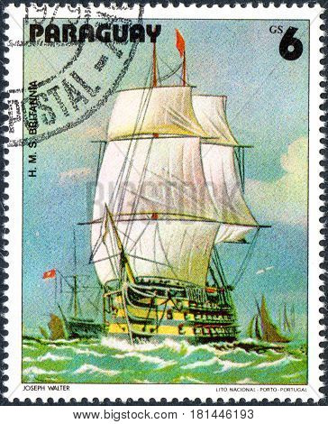 UKRAINE - CIRCA 2017: A postage stamp printed in Paraguai shows Sailing Ship HMS Britannia from the series Sailboat painting circa 1979