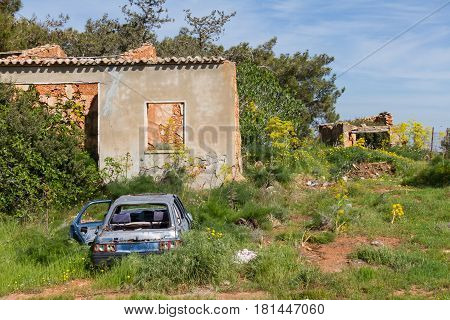 Derelict house and car in Diorios village in the island of Cyprus in the mediterranean