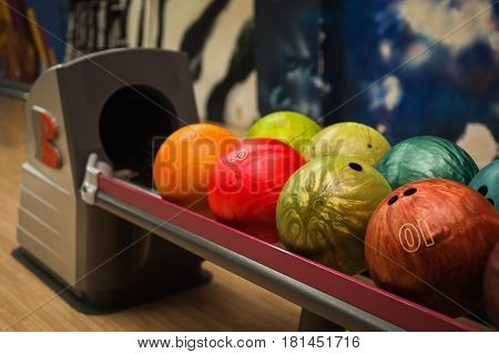 Colored bowling balls. Games and entertainment with friends. Sports equipment. Play bowling. Bowling concept