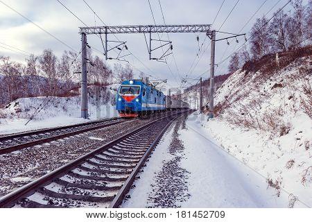 Passenger train moves along Baikal lake. Trans Siberian railway. Russia.