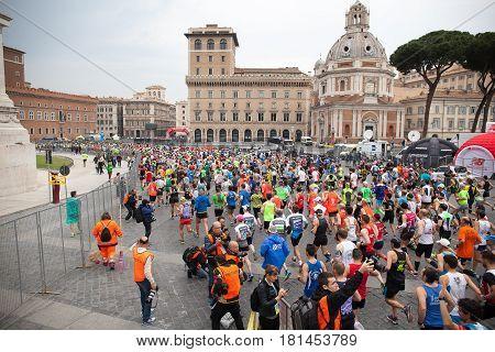 Rome Italy - April 2 2017: the departure of the athletes on Via dei Fori Imperiali.