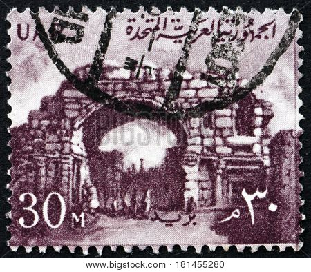 EGYPT - CIRCA 1959: a stamp printed in Egypt shows St. Simon's Gate Bosra Syria circa 1959